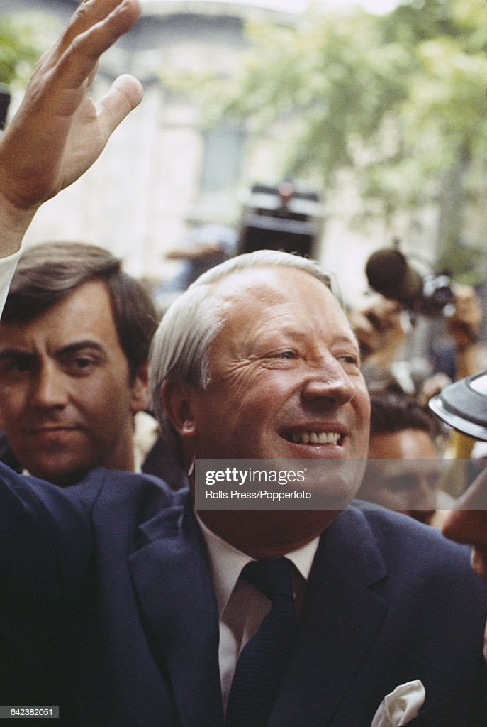English Conservative party politician Edward Heath waves to supporters outside Conservative Party headquarters in Smith Square London on 19th June...