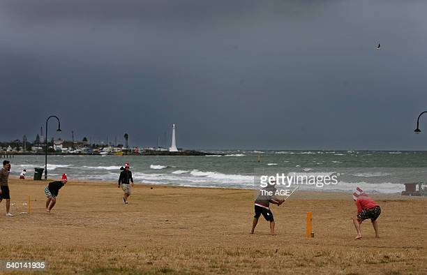 English cricket fans hone their skills with a game of beach cricket at St Kilda beach on Christmas Day Some of the group had just flown 30 hours to...