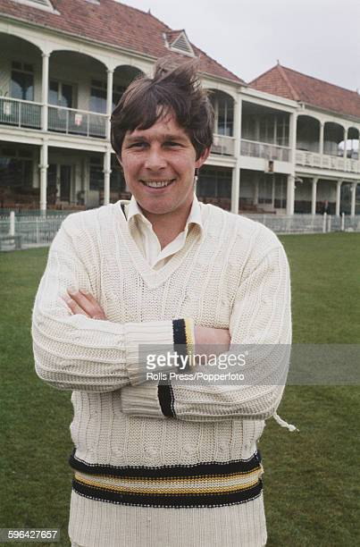 English cricketer and player for Hampshire County Cricket Club Alan Castell posed in front of the main stand and club house at the County Ground in...