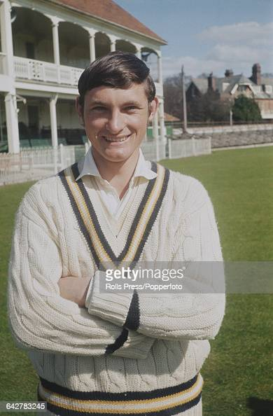English cricketer and player for Hampshire County Cricket Club David Turner posed in front of the main stand and club house at the County Ground in...