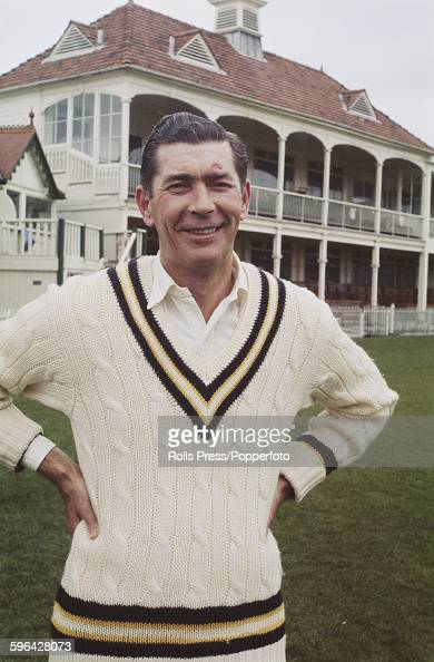 English cricketer and player for Hampshire County Cricket Club Derek Shackleton posed in front of the main stand and club house at the County Ground...