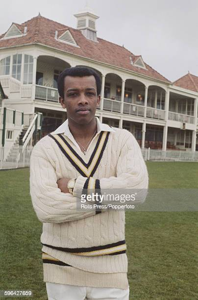 English cricketer and player for Hampshire County Cricket Club John Holder posed in front of the main stand and club house at the County Ground in...