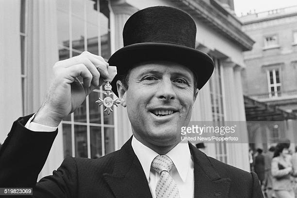 English cricketer Geoffrey Boycott holds his OBE at an investiture ceremony at Buckingham Palace in London on 11th November 1980