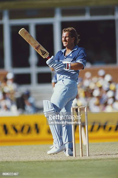 English cricketer Ian Botham pictured in action batting for England during play against Australia in the Benson Hedges Challenge one day...