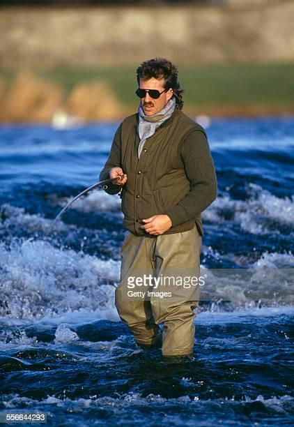 English cricketer Ian Botham salmon fishing in Scotland circa 1990