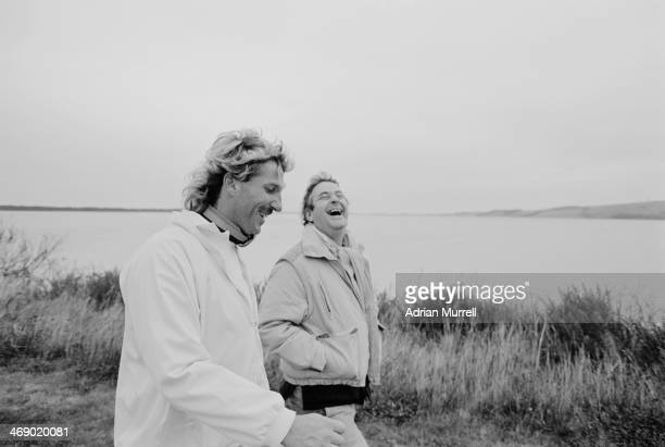 English cricketer Ian Botham with sports journalist Frank Keating during a charity walk 1988