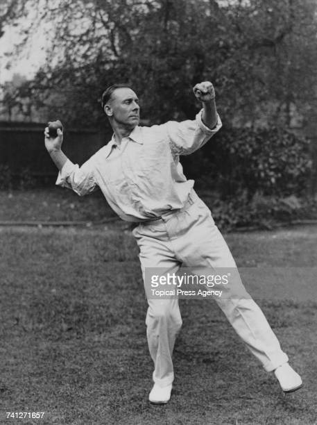 English cricketer Jack Hobbs demonstrating the correct way to throw in a ball circa 1925