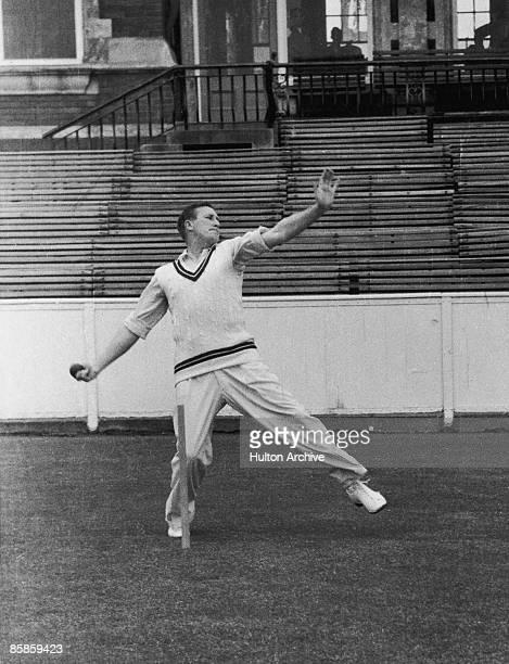 English cricketer Jim Laker of Surrey CCC bowling 1956