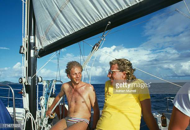 English cricketers David Gower and Ian Botham relaxing on a yacht in the Caribbean during the England tour of the West Indies 1986