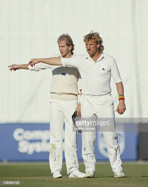 English cricketers Ian Botham and David Gower both gesture to the outfield during the England vs West Indies Wisden Trophy Fourth Test on 27th July...