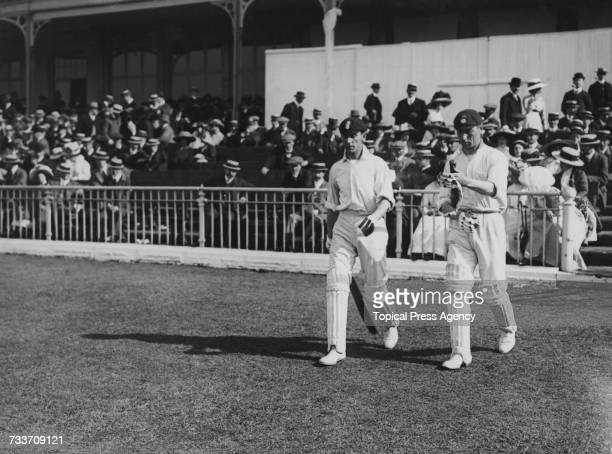 English cricketers Jack Hobbs and Phil Mead go out to bat for Pelham Warner's team against Gilbert Jessop's team in a Test Trial at Bramall Lane...