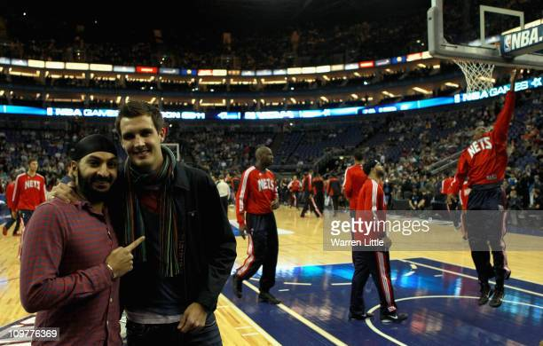 English crickets Monty Panesar and Steven Finn pose for a picture ahead of the NBA match between New Jersey Nets and the Toronto Raptors at the O2...