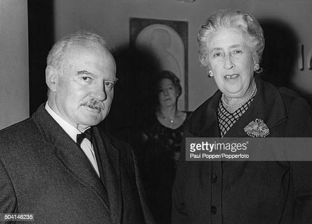 English crime novelist short story writer and playwright Agatha Christie and her husband British archaeologist Max Mallowan attend the first night of...