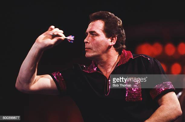 English darts player Bobby George competing in the Embassy BDO World Darts Championship at the Lakeside Country Club in Frimley Green Surrey 18th...