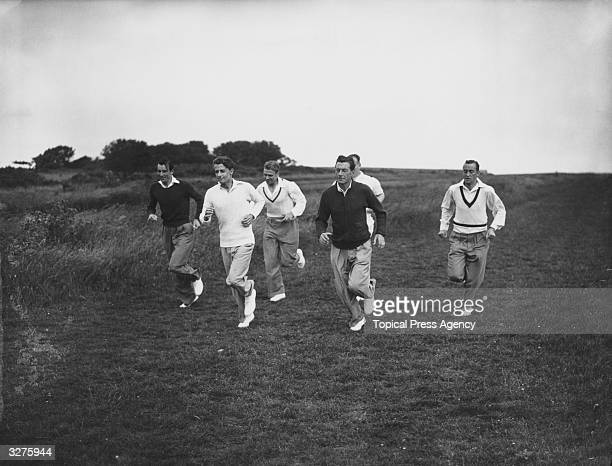 English Davis Cup tennis team members Fred Perry Bunny Austin Raymond Tuckey Dan Maskell and Pat Hughes training on Beachy Head Sussex 14th July 1936...