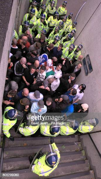 English Defence League supporters are are corralled in a subway by police during their demonstration in Birmingham