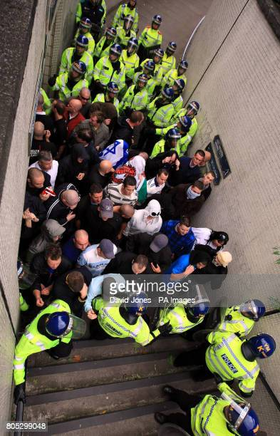 English Defence League supporters are corralled in a subway by police during their demonstration in Birmingham