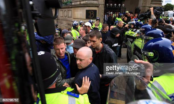 English Defence League supporters are herded to waiting buses by police during a demonstration in Birmingham