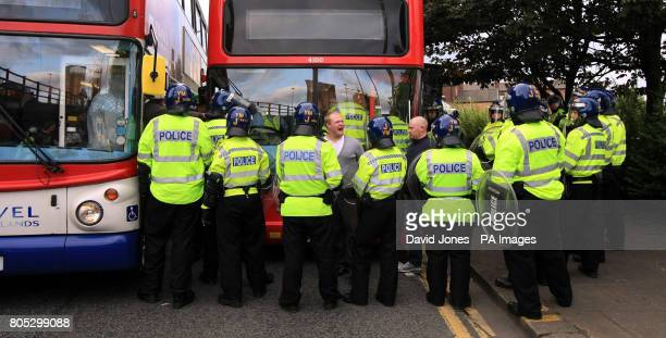 English Defence League supporters are herded to waiting buses by police during their demonstration in Birmingham