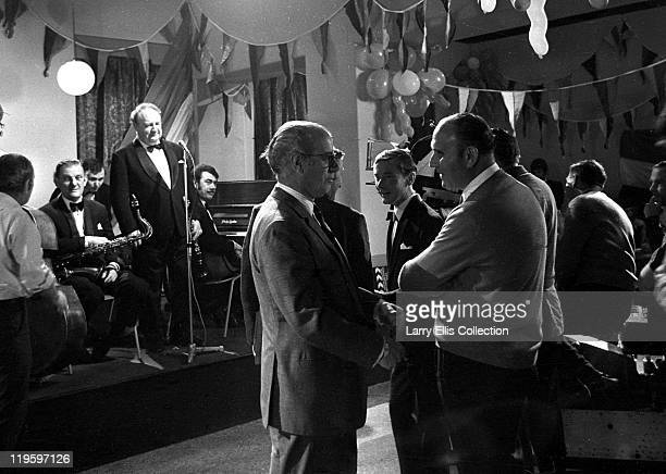 English director Gerald Thomas chatting with producer Peter Rogers on the set of the film 'Carry On Again Doctor' 1969 Actor Kenneth Williams is...