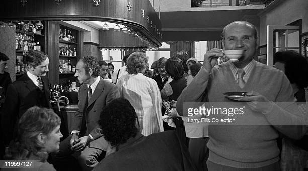 English director Gerald Thomas drinking tea on the set of the film 'Carry On at Your Convenience' 1971 In the background actor Kenneth Williams chats...