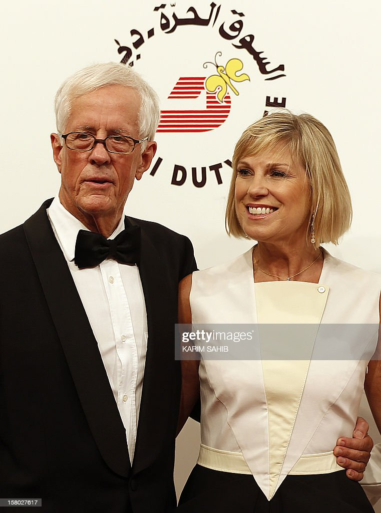 English director Michael Apted (L) and his wife Jo attend the opening ceremony of the Dubai International Film Festival in the Gulf emirate of Dubai on December 9, 2012.