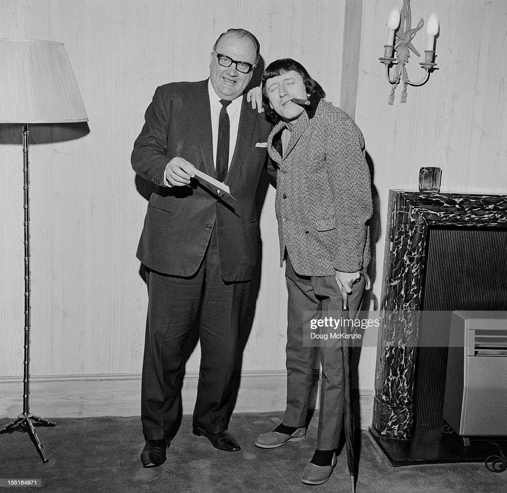 English disc jockey and television presenter Jimmy Savile (1926 - 2011) with Geoffrey Everett of Radio Luxembourg (left), March 1966.