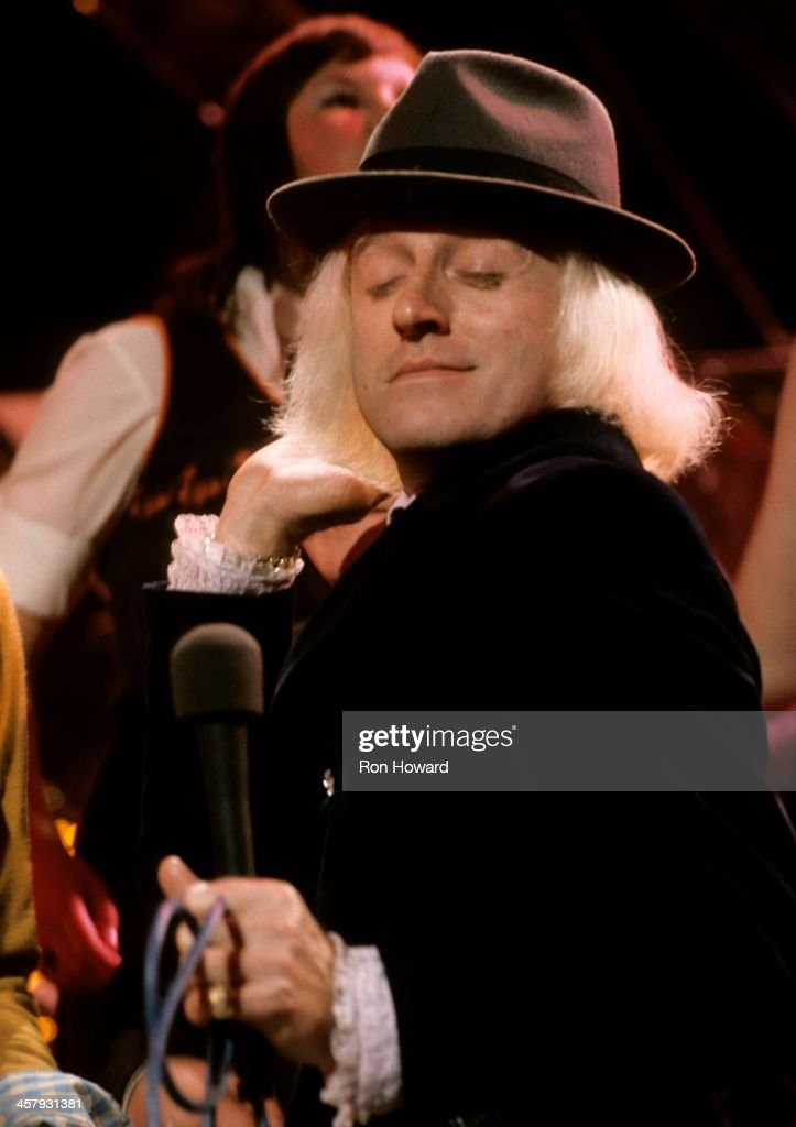 English DJ and television presenter Jimmy Savile (1926-2011) presents BBC TV's Top Of The Pops in London circa 1970.