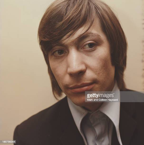 English drummer and member of The Rolling Stones Charlie Watts posed backstage circa 1965