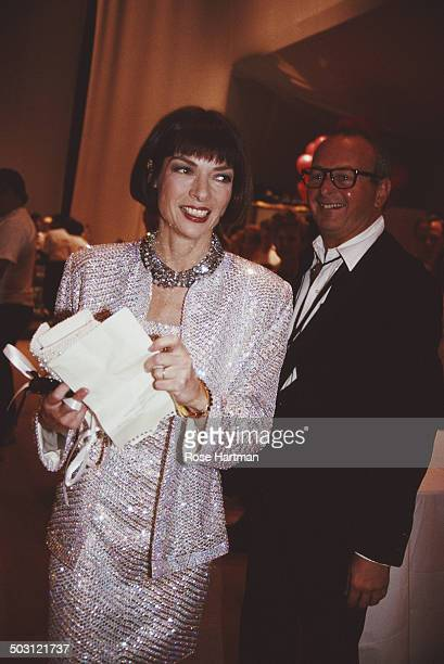 English editorinchief of American Vogue Anna Wintour and American fashion photographer Arthur Elgort attend an event at the Bergdorf Goodman store...