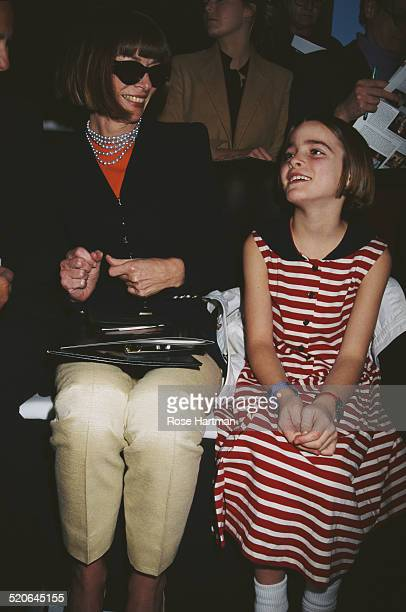 English editorinchief of American Vogue Anna Wintour and her daughter attend a fashion show for the Donna Karan Fall '96 Collection 1996