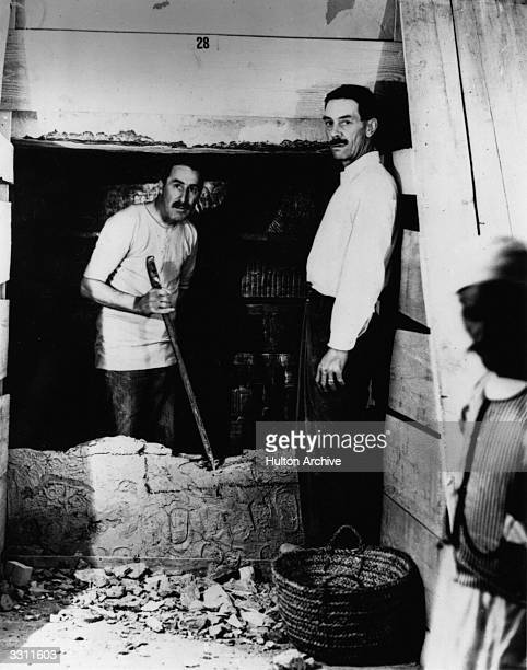 English egyptologist Howard Carter and Mr Mace opening the wall of the inner chamber of Tutankhamen's tomb