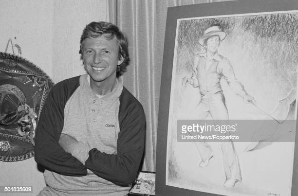 English entertainer actor and singer Tommy Steele posed next to a portrait of himself in London on 9th September 1985