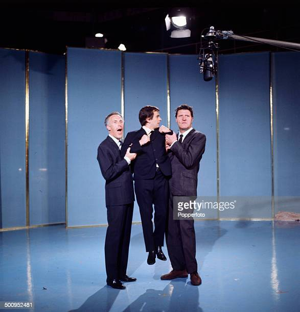 English entertainer Bruce Forsyth on left pictured with the actor and comedian Dudley Moore in centre and magician and comedian Tommy Cooper on right...