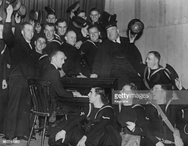 English entertainer Dickie Henderson entertains the men of the Royal Navy accompanied by Charlie Kunz on the piano somewhere in the west of England...