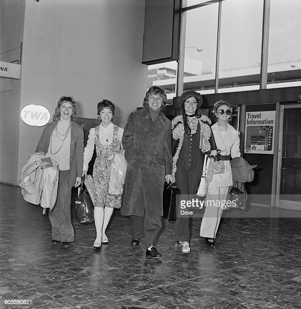 English entertainer Tommy Steele witha troupe of dancers at London Airport bound for Las Vegas 13th February 1971 The dancers are Michele Hardy Dawn...
