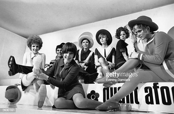English fashion designer Mary Quant centre front at the launch of her 'Quant Afoot' range of boots in fashion colours The boots are covered in clear...