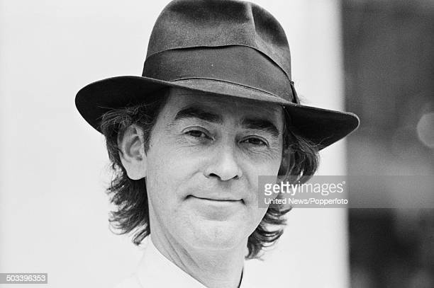 English fashion designer Ossie Clark pictured wearing a fedora style hat in London on 27th September 1984