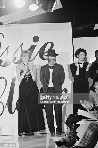 English fashion designer Ossie Clark posed with models on a runway at his fashion show in London on 13th March 1984