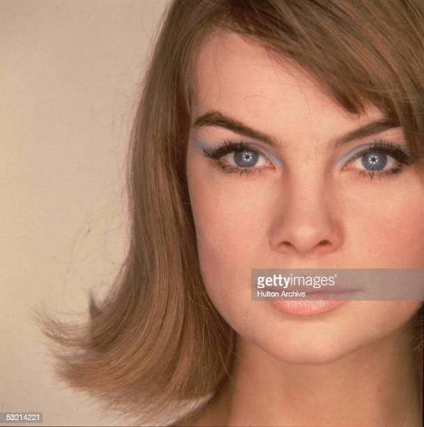 English fashion model Jean Shrimpton looks at the camera wearing heavy blue eyeshadow 1960s