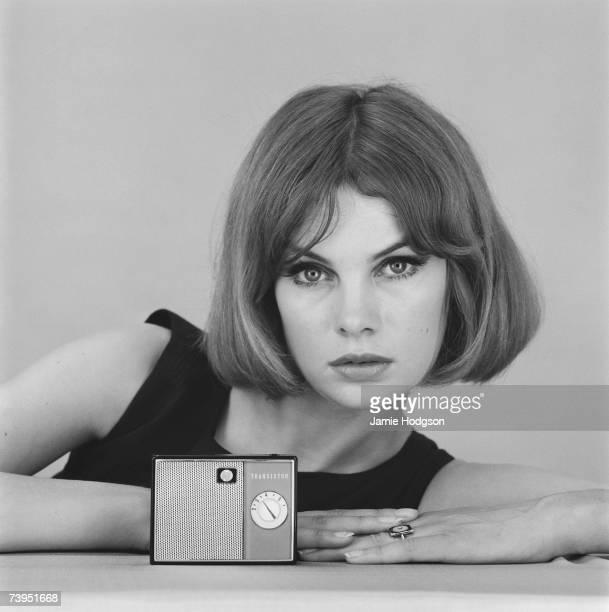 English fashion model Jean Shrimpton with a mini transistor radio 5th September 1961