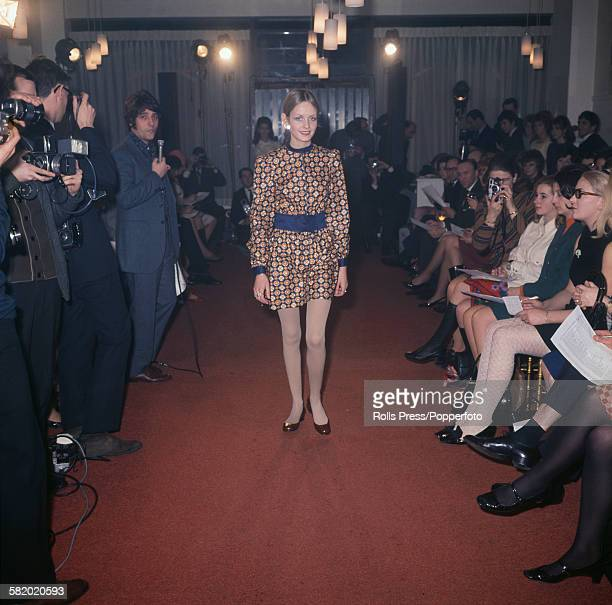 English fashion model Twiggy pictured modelling a belted mini dress at a fashion show at a boutique in London on 18th January 1968 Twiggy's manager...