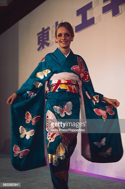 English fashion model Twiggy pictured wearing a turquoise silk kimono on a catwalk during a fashion show in Japan in October 1967