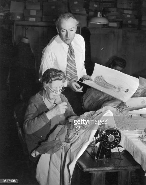 English fashion photographer and costume designer Cecil Beaton discusses his work with Mrs Garrett a member of the wardrobe staff 1945