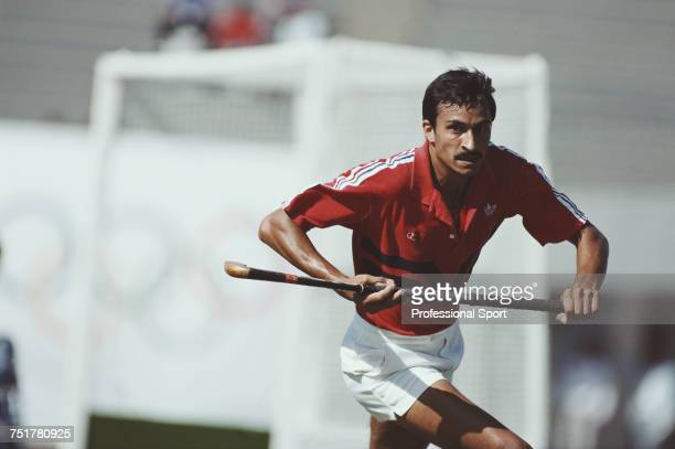 English field hockey player Imran Sherwani pictured in action for the Great Britain team during a match in the Men's field hockey tournament during...