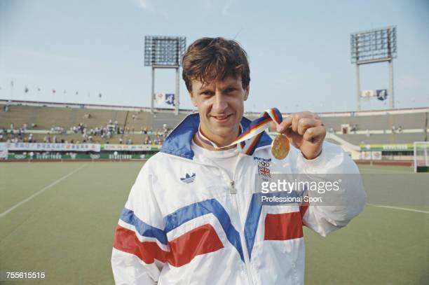 English field hockey player Sean Kerly of the Great Britain team pictured holding his gold medal after the Great Britain team beat West Germany 31 in...