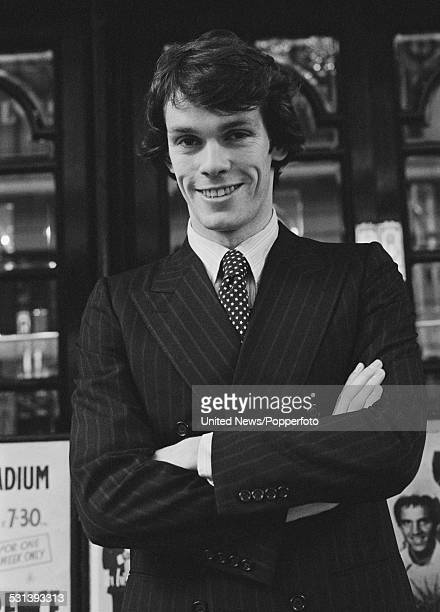 English figure skater John Curry pictured standing outside the Palladium Theatre in London on 16th March 1977 Curry is to appear in a production of...