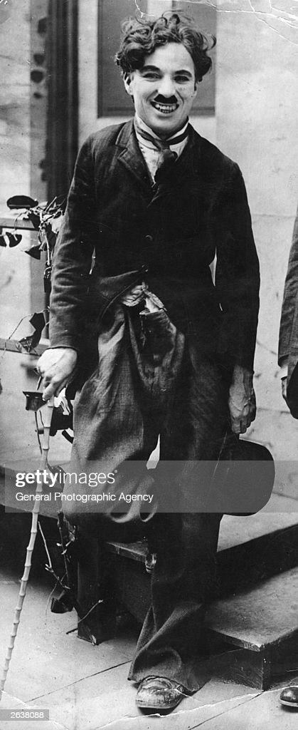 English film actor and director <a gi-track='captionPersonalityLinkClicked' href=/galleries/search?phrase=Charlie+Chaplin&family=editorial&specificpeople=70006 ng-click='$event.stopPropagation()'>Charlie Chaplin</a> (1889 - 1977) between takes during the filming of the 1917 silent film 'Easy Street'. Original Publication: People Disc - HW0511