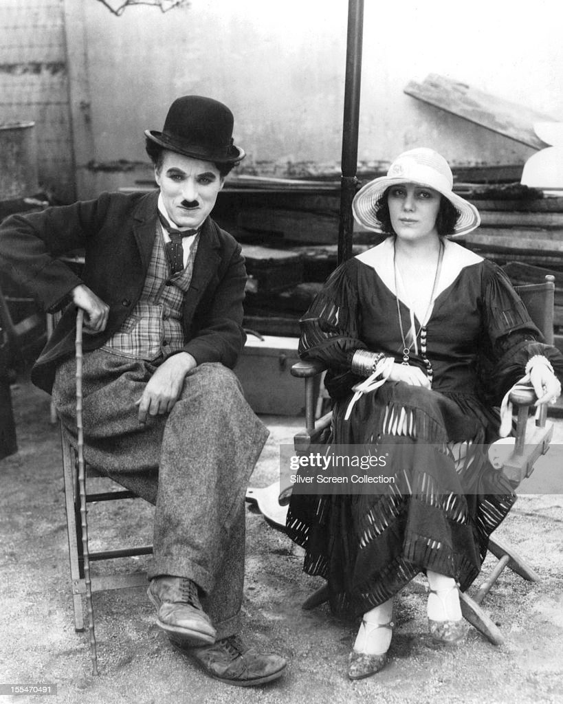 English film actor and director <a gi-track='captionPersonalityLinkClicked' href=/galleries/search?phrase=Charlie+Chaplin&family=editorial&specificpeople=70006 ng-click='$event.stopPropagation()'>Charlie Chaplin</a> (1889 - 1977) with American silent film actress <a gi-track='captionPersonalityLinkClicked' href=/galleries/search?phrase=Edna+Purviance&family=editorial&specificpeople=90755 ng-click='$event.stopPropagation()'>Edna Purviance</a> (1895 - 1958), circa 1918.