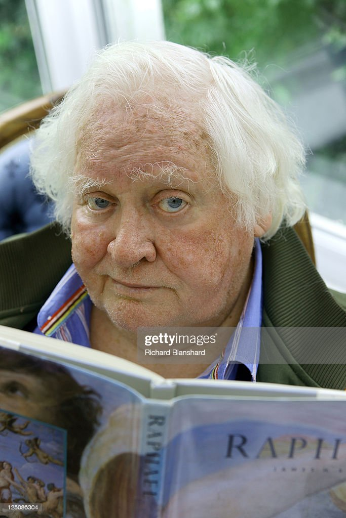English film director Ken Russell reads a book on Italian Renaissance artist Raphael, circa 2009.